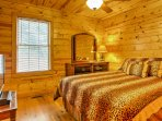 The downstairs bedroom has a queen mattress and nightstand with large mirror.