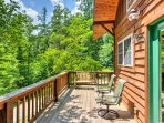 Step outside on the large wraparound deck to enjoy the serene forest views.