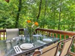 Host a lovely meal at the outdoor dining room area for your guests.
