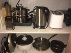 Baccarat cookware, coffee/tea, basic pantry items, dishwasher, microwave, fridge, freezer, table