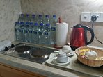 We provide 6 big bottles and 12 small bottles of mineral water for you.