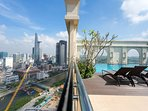 view to Bitexco Tower from rooftop swimming pool