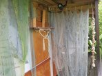 The shower uses hand made fishing nets donated by the fishermen as a shower curtain