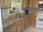 Fully Stocked Kitchen with granite