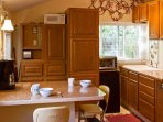 This delightful kitchenette is perfect for preparing a quick snack.
