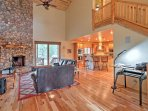 You'll love the open layout and tall ceilings of this Pinetop paradise.