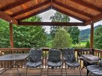This back deck overlooks Gales Creek and the Oregon Coast Range, offering serene views and spectacular sunsets.