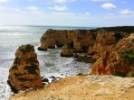 View of the cliffs and caves at Marinha Beach