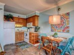 A well equipped kitchen with a full size fridge, microwave, oven, stovetop, coffee maker, and many cooking tools to...