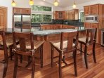 Spacious kitchen with stainless steel amenities and a granite breakfast bar