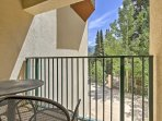 You can enjoy views of the resort pool and towering trees from the private patio.