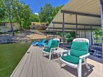 The lakefront house has a private dock to accommodate 2 boats and comfortable beach chairs.