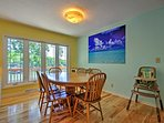 Six guests can dine together at the table adjacent to the living room.