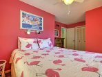 The second bedroom has a queen-sized bed with a festive flamingo comforter!