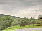 Relish the home's vast private land and unbeatable mountain views!
