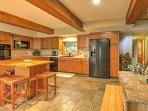 Have a seat at the 4-person kitchen island for a quick bite to eat!