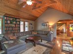 The home's second sitting area boasts high cathedral ceilings and ample space to relax on the plush leather couch!