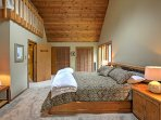 When you're ready to retire for the night, head to the master bedroom where you'll find a plush king sized bed.
