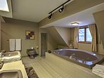 The pristine master bath plays host to a Jacuzzi tub and Jack and Jill sinks.