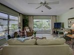 Decorated in Tommy Bahama furnishings, your living space opens into the screened lanai.