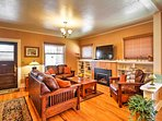 Comfortable leather seating faces a gas fireplace and large flat-screen cable TV in the living room, where you can...