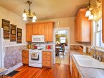 The kitchen's large tile-countertops and modern appliances, including a gas-burning stove provide everything you'll...