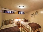 The downstairs bedroom offers 2 twin-sized beds, ideal for younger travelers.