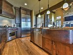 Granite counter tops, unique wooden cabinetry, and stainless steel appliances make it fun to cook in this gourmet...