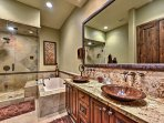 Each bathroom in the home features gleaming copper fixtures and is meticulously decorated to match the aesthetic of the...