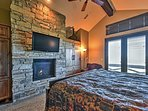The larger bedrooms each feature a gorgeous gas-burning fireplace and its own flat-screen cable TV!