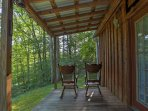 Enjoy your stay at the cabin while relaxing in the rocking chairs on the porch.