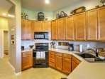 Cook up a delicious home-cooked concoction in the fully equipped kitchen.
