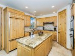 Open Kitchen with Doors to Deck with BBQ