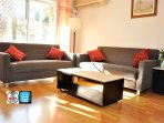 Sunny spacious living room with 2x2.5 seat sofa