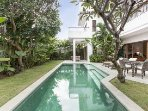 Pool and garden view from Balinese daybed