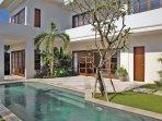 Pool and villa at midday