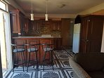 Kitchen with bar counter and bar chairs