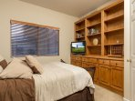 Guest Bedroom Down Stairs with Queen Bed and TV