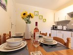 Dining area with ample space for four people to dine in comfort