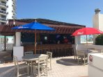 Poll side Tiki Bar serving food and drinks SEASONAL
