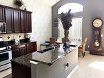 Kitchen and Dining Area w/  Custom Seating and Grandfather Clock