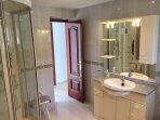Large spacious family bathroom with walk in Jet Shower cubicle.