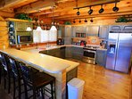 Huge Kitchen provides room for multiple cooks. Fully stocked with all pots, pans, utensils to cook.