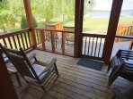 Screen Porch off Great Room with 3 Cracker Barrel Rockers. Best space to sit & enjoy birds singing