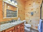 The third bathroom features a walk in shower.