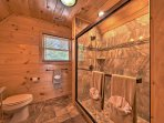 The fourth bathroom offers a walk in shower.