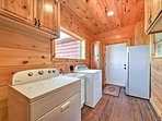 In-unit laundry machines are located just off the kitchen.