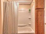 The full bathroom has a shower/tub combo