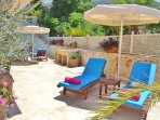 Poolside terrace has built in stone BBQ and sea views