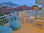 Large furnished private terrace off master bedroom with drinks table and sunbeds